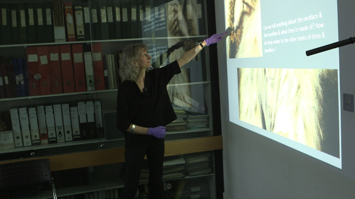 Fig. 3 Clare Browne considers the lace cuff in the portrait
