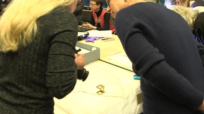 Fig. 4 Katy Bond & Susanna Burghartz examine a piece of lace-edged linen